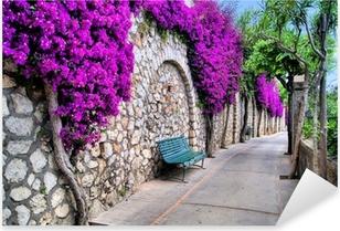 Pixerstick Sticker Klein straatje met een oude muur vol paarse bloemen
