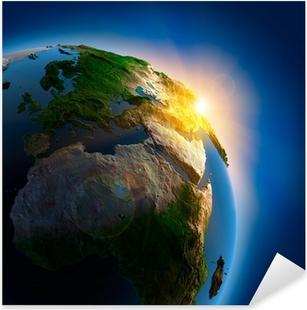 Sticker Pixerstick Lever de soleil sur la Terre dans l'espace