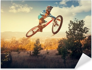 Man high jump on a mountain bike. Downhill cycling. Pixerstick Sticker