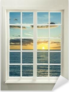 Pixerstick Sticker Moderne venster woonwijken met zonsondergang over zee en wolken