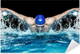 Muscular young man in blue cap in swimming pool Pixerstick Sticker