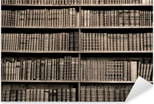 Old books in a library - sepia image Pixerstick Sticker