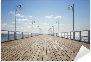 Old empty wooden pier over the sea shore with copy space Pixerstick Sticker