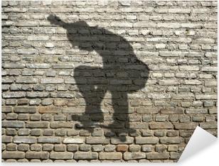ombre de skate-boarder sur mur de briques Pixerstick Sticker