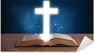 Open holy bible with glowing cross in the middle Pixerstick Sticker