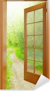 Opened door to early morning in green garden. Pixerstick Sticker