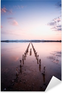 Poles in perspective on the pond, at sunset in a perfect calm day- calmness and silence concept Pixerstick Sticker