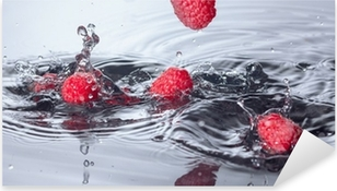 Red Raspberries Dropped into Water with Splash Pixerstick Sticker