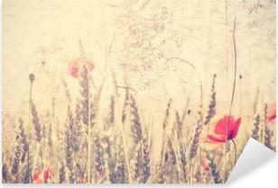 Pixerstick Sticker Retro vintage gefilterd wilde weide met poppy bloemen bij zonsopgang
