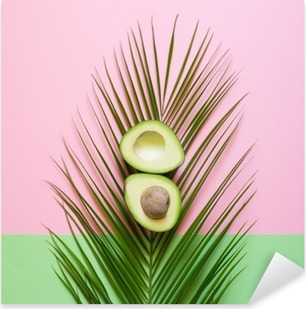 Ripe Avocado on palm leaf on a colored background. Minimal concept Pixerstick Sticker
