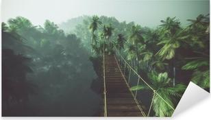 Rope bridge in misty jungle with palms. Backlit. Pixerstick Sticker