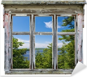 Scenic view seen through an old window frame Pixerstick Sticker