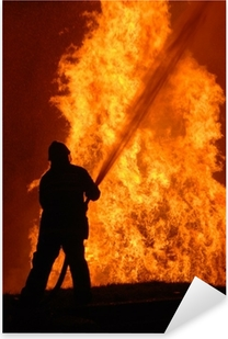 Sticker Pixerstick Seul pompier lutte contre le feu faisant rage