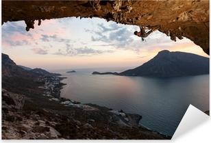 Silhouette of a rock climber at sunset. Kalymnos Island, Greece. Pixerstick Sticker