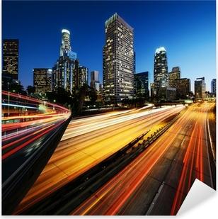 Pixerstick Sticker Stad van Los Angeles California bij zonsondergang met lichte slepen