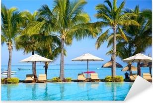 Swimming pool with umbrellas on beach in Mauritius Pixerstick Sticker