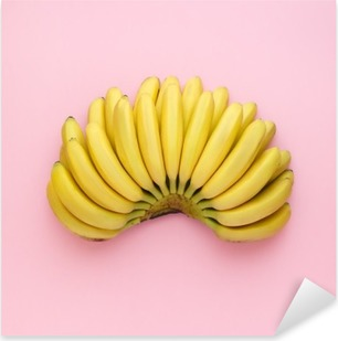Top view of ripe bananas on a bright pink background. Minimal style. Pixerstick Sticker