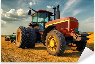 Tractor on the agricultural field Pixerstick Sticker