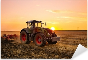 Tractor on the barley field by sunset. Pixerstick Sticker