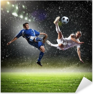 two football players striking the ball Pixerstick Sticker