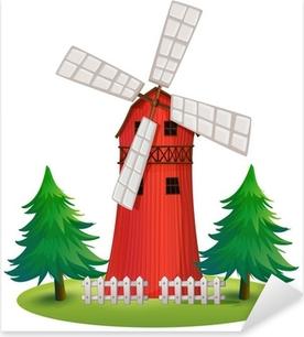 Sticker Pixerstick Un grand bâtiment en bois avec un moulin à vent