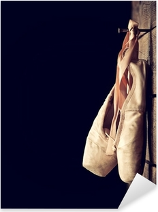 Used ballet shoes hanging on wooden background Pixerstick Sticker