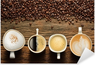 Variety of cups of coffee and coffee beans on old wooden table Pixerstick Sticker