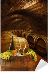 Vine cellar with glasses of white vine against barrels Pixerstick Sticker