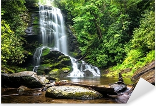 Waterfall amidst the forest greenery Pixerstick Sticker