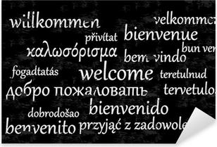 Pixerstick Sticker Welkom geschreven in verschillende talen op een schoolbord