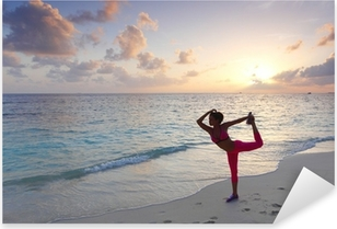 Woman stretching on beach Pixerstick Sticker