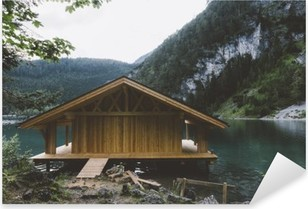Wood house on lake with mountains and trees Pixerstick Sticker