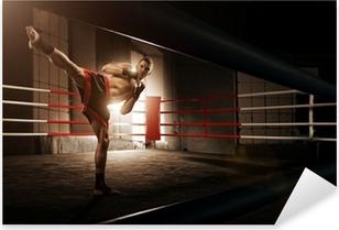 Young man kickboxing in the Arena Pixerstick Sticker