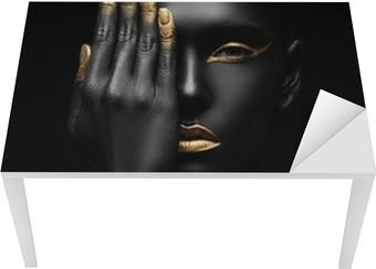 dark-skinned woman with golden make-up. Table & Desk Veneer