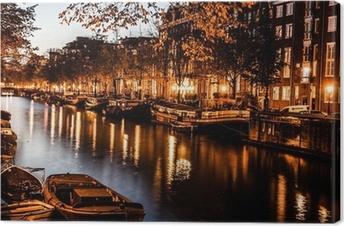 Tableau sur toile Amsterdam dans la nuit, les Pays-Bas