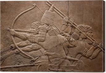 Tableau sur toile Ancient relief assyrien de guerriers combattant dans la guerre