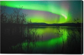 Tableau sur toile Aurores boréales en miroir sur le lac