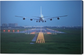 Tableau sur toile Avion de voler au-dessus de la piste de décollage de l'aéroport
