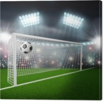 Tableau sur toile Ballon de football vole dans le but