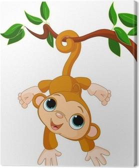 Tableau sur toile Bébé singe sur un arbre