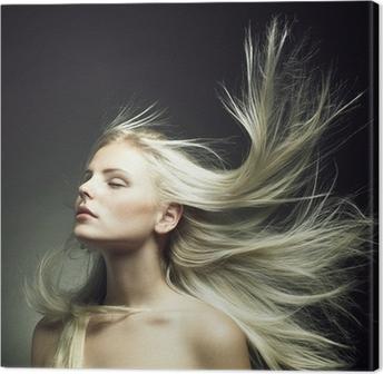 Tableau sur toile Belle femme aux cheveux magnifique