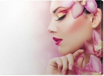 Tableau sur toile Belle Fille Avec Fleurs d'orchidée. Parfait Make-up