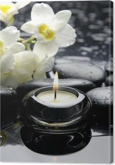 Tableau sur toile Bougies d'aromathérapie et de pierres zen avec la branche orchidée blanche