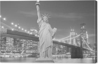 Tableau sur toile Brooklyn Bridge et la Statue de la Liberté la nuit