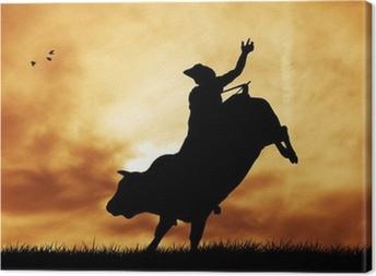 Tableau sur toile Bull cavalier au coucher du soleil