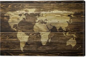 Tableau sur toile Carte du monde sur fond de bois