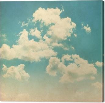 Tableau sur toile Ciel bleu avec des nuages dans le style grunge.