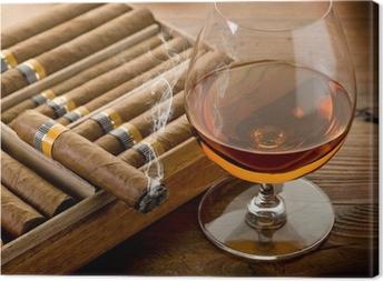 Tableau sur toile Cigare cubain et cognac sur fond de bois
