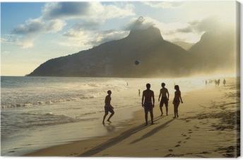 Tableau sur toile Coucher de soleil Silhouettes Jouer Altinho Futebol football de plage au Brésil
