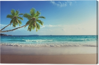 Tableau sur toile Coucher de soleil sur la plage des Seychelles